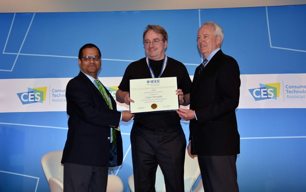 Linus Torvalds receiving 2018 IEEE Masaru Ibuka Consumer Electronics Award from ICCE 2018 Conference Chair Saraju P. Mohanty, and IEEE President James A. Jefferies at ICCE 2018 on 12 Jan 2018 at Las Vegas.